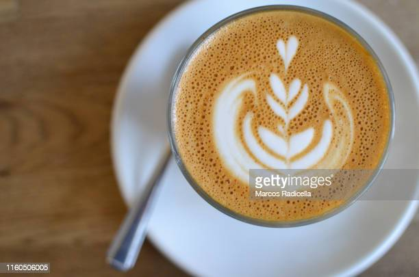 coffee with latte art - radicella stock pictures, royalty-free photos & images