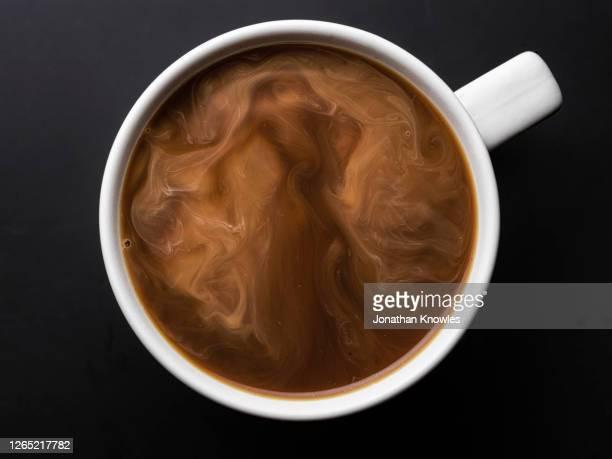 coffee with milk - brown stock-fotos und bilder