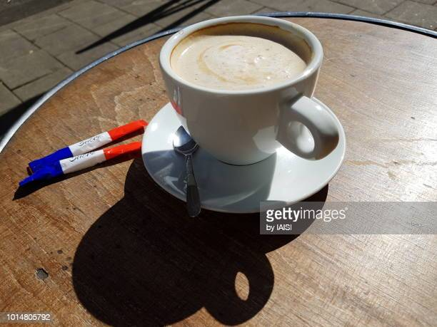 Coffee with the French colors, on the sugar, writing reads 'Sucre', 'sugar'