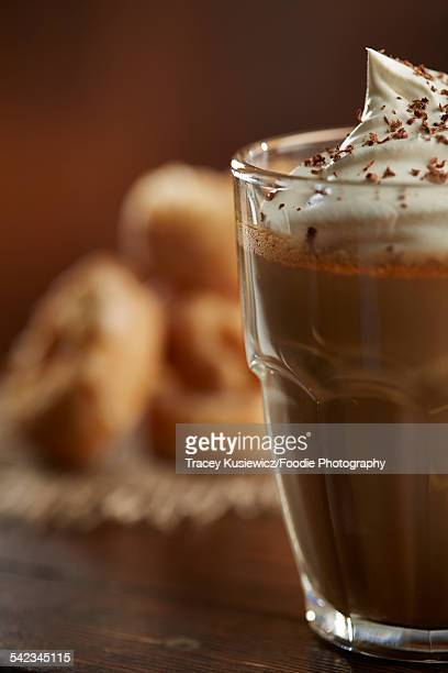 Coffee with whip cream and doughnuts