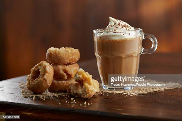 Coffee with whipped cream and doughnuts