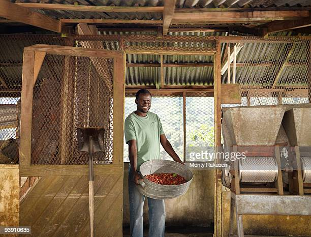 Coffee Worker With Coffee Beans