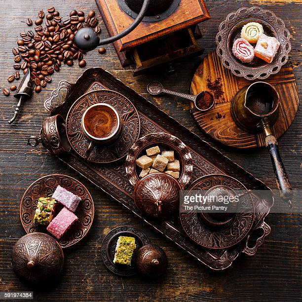 Coffee-east and Turkish Delight on copper tray on wooden background