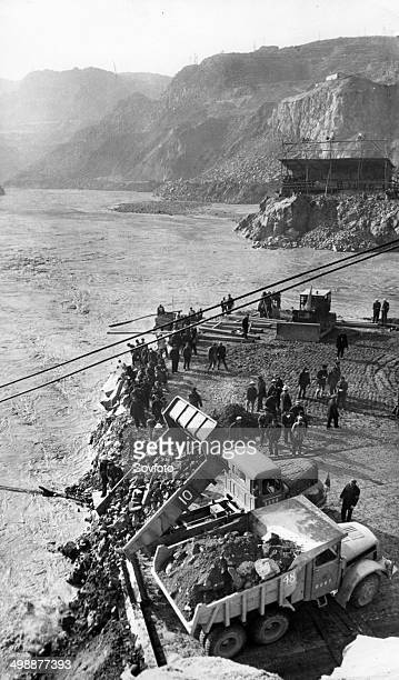 Cofferdam for Sanmen Gorge project along the Yellow River A highway leading from Devil's Gate to God's Gate was built to facilitate the damming of...