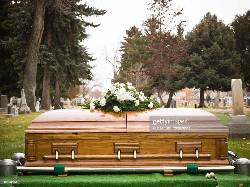 coffin at a cemetery : Stock Photo