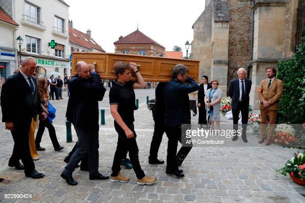 Coffin bearers carry the coffin of late French actor Claude Rich for the funeral ceremony into the Saint Pierre Saint Paul Church in Orgeval...
