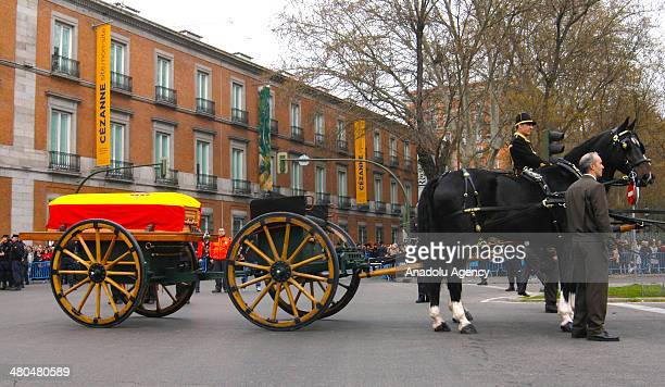 Coffin bearing former Spanish Prime Minister Adolfo Suarez is carried out from the funeral chapel in the Spanish parliament in Madrid Spain on March...