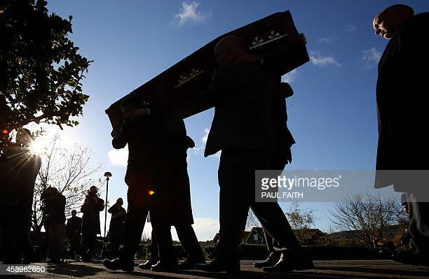 A coffin bearing the remains of murdered Brendan Megraw is carried after a funeral service in Belfast Northern Ireland on November 14 2014 Brendan...