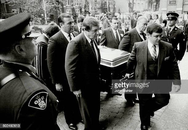 Coffin carried to cathedral Pallbearers including AttorneyGeneral Roy McMurtry carry the coffin of former Ontario ombudsman Arthur Maloney into St...