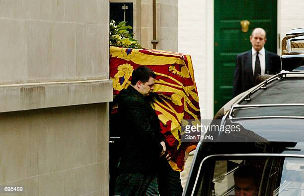 A coffin carrying the body of Britains Princess Margaret draped in the Royal Ensign is carried to a hearse February 9 2002 from the King Edward VII...