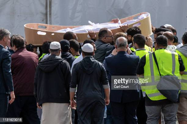 Coffin containing the body of a victim of the Christchurch terrorist attack is carried for burial at Memorial Park Cemetery on March 20, 2019 in...