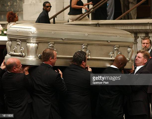A coffin containing the body of RB singer Aaliyah is carried into St Ignatius Loyola Church August 31 2001 during funeral services in New York City...