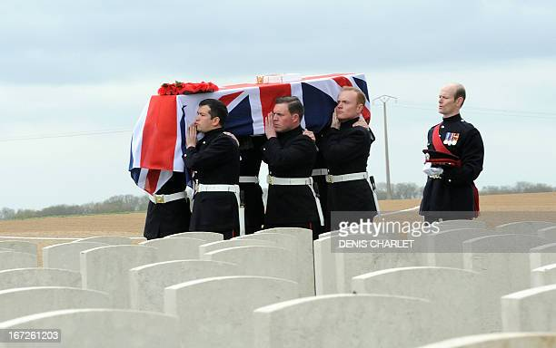 A coffin containing the remains of a British soldier is carried on April 23 2013 in the Honourable Artillery Company Cemetery at EcoustSaint Mein as...