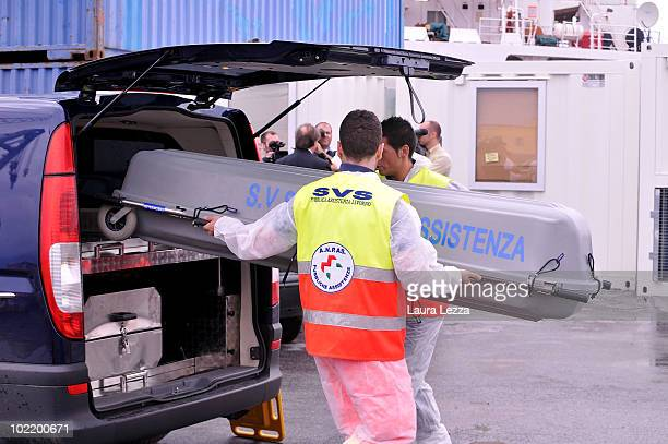 A coffin holding the body of a truck driver killed at the industrial port of Livorno is taken away on June 17 2010 in Livorno Italy So far two people...