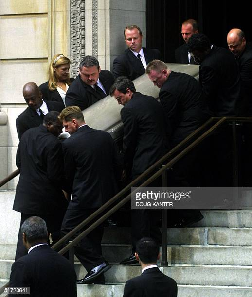A coffin holding the body of US pop singer Aaliyah is carried from St Ignatius Loyola Church following funeral services in New York 31 August 2001...