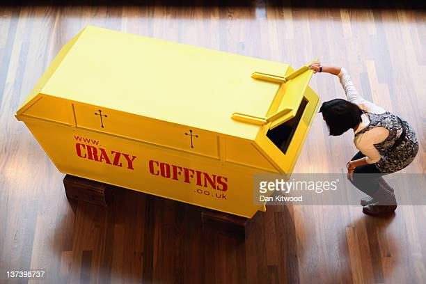 A coffin in the shape of a skip is displayed at the South bank Centre on January 20 2012 in London England A collection of bespoke coffins by 'Crazy...