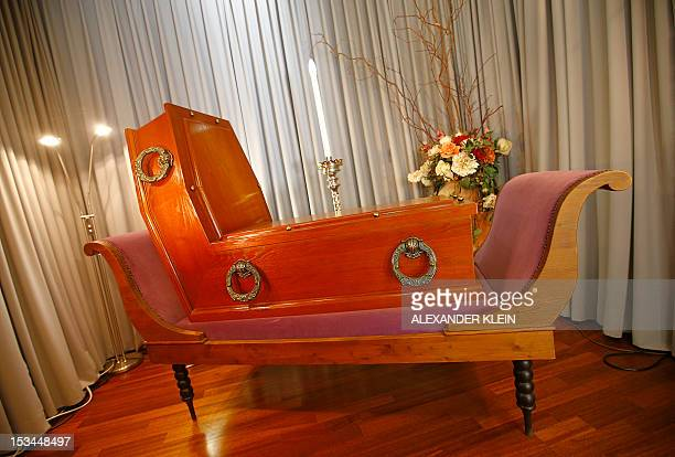 A coffin inspired by Belgian painter Rene Magritte creation 'Perspective Madame Recamier de David' is seen at the Funeral museum of Vienna on October...