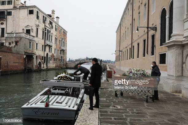 Coffin is brought out of the hospital in the presence of the funeral home employee, to be loaded onto the funeral boat towards the cemetery on March...