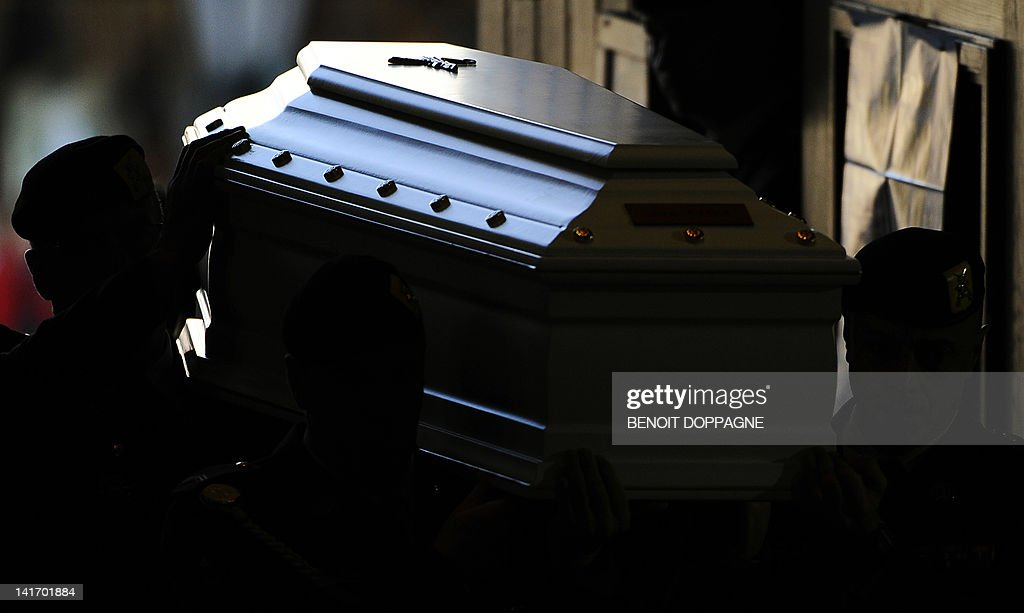 A coffin is carried on March 22, 2012 into the Sint-Pieters church in Leuven during a funeral service for the seven children from Heverlee, who were killed in the March 13 bus crash in Switzerland. Twenty-eight people were killed in the crash in a tunnel in Sierre, southern Switzerland, including 22 children from two schools in Lommel and Heverlee on their way home from a ski vacation.