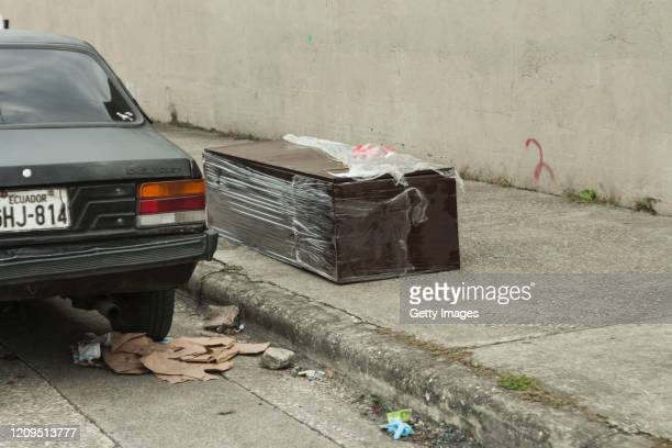 A coffin is seen lien on the sidewalk outside Jardines de la Esperanza cemetery on April 8 2020 in Guayaquil Ecuador According to official...
