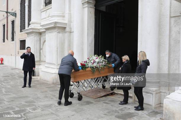 Coffin is taken out of the hospital in the presence of two relatives and a funeral home employee on March 10, 2020 in Venice, Italy. According to the...