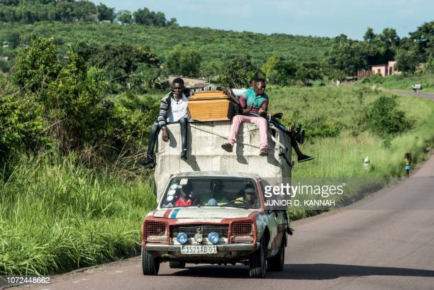 A coffin is transported on a pick up driving on the road that leads from Matadi to Kinshasa on November 10 2018 From the port of Matadi to the...
