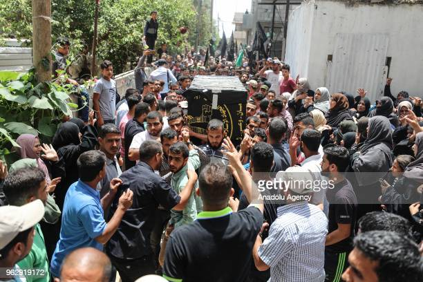 A coffin of a Palestinian who was killed in an Israeli shelling of the southern Gaza Strip is being carried during his funeral ceremony in Khan Yunis...