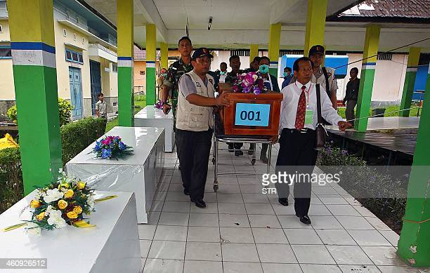 A coffin of a victim of AirAsia flight QZ8501 is transferred from a local hospital in Pangkalan Bun the town with the nearest airstrip to the crash...