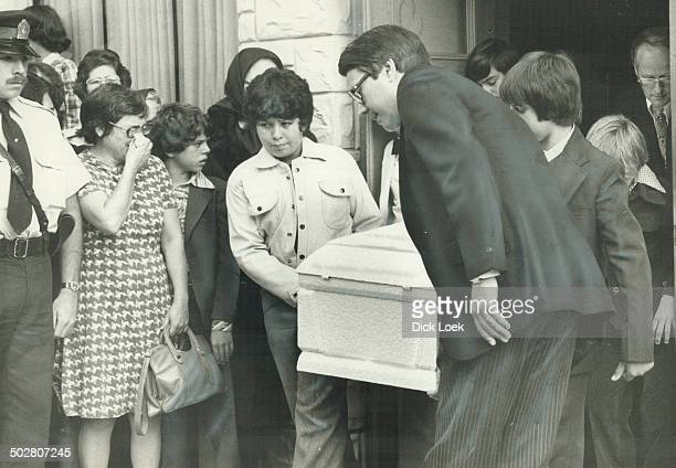 Coffin of slain shoeshine boy Emanuel Jaques is carried from St Agnes Church yesterday by young friends as more than 4000 people mourned at his...