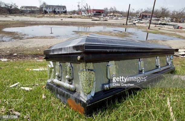 A coffin rests on the levee across the street from the cemetary on September 6 2005 in Port Sulfur Louisiana Hurricane Katrina Hit the area August...