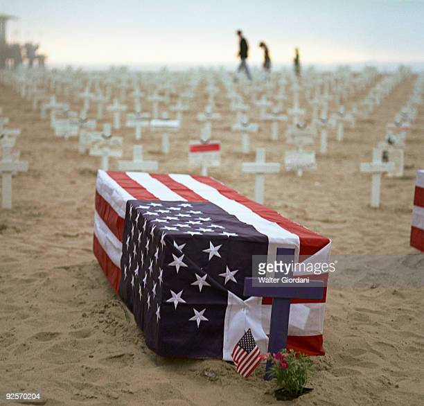 Coffin with American flag on beach