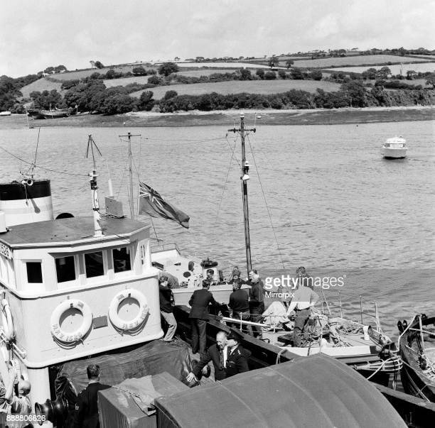 A coffin with one of the victims bodies from the missing pleasure boat Darlwyne being brought ashore by lifeboats at Falmouth docks The Falmouth...