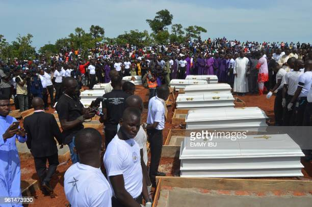 Coffins are prepared for burial during a funeral service for 17 worshippers and two priests who were allegedly killed by Fulani herdsmen at...