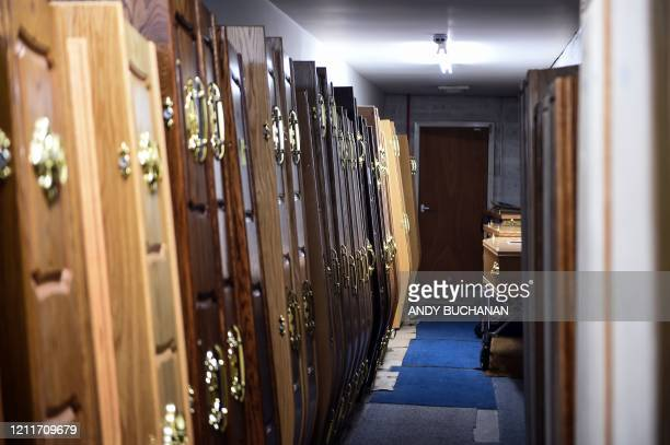 Coffins are seen in the mortuary at Emslie S. Collier and Son Funeral Directors in Montrose, east Scotland on May 4 ahead of the funeral service of...