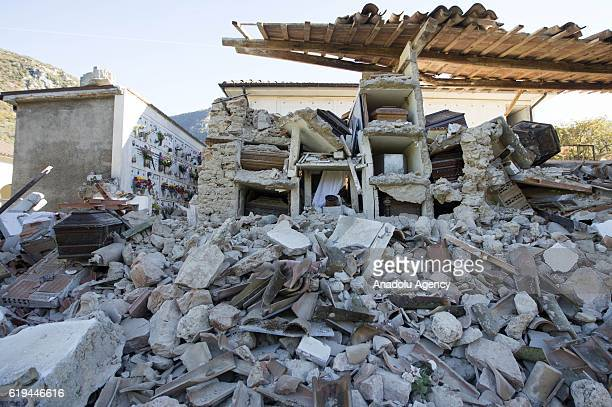 Coffins are seen out of their niches in the collapsed cemetery of the village of Campi, Italy, the day after the earthquake that hit central Italy,...