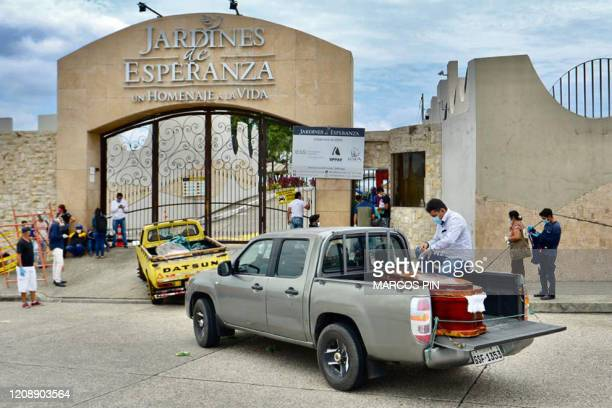 Coffins are transported into a cemetery on trucks in Guayaquil Ecuador on April 1 2020 Residents of Guayaquil in Ecuador's southwest express outrage...