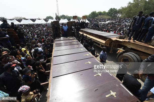 Coffins arrive at Ibrahim Babanginda Square in the Benue State capital Makurdi on January 11 during a funeral service for scores who died following...