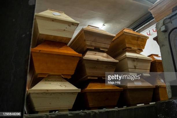 Coffins carrying mainly Covid-19 victims lie on a trolley at the city crematorium during the second wave of the coronavirus pandemic on January 11,...
