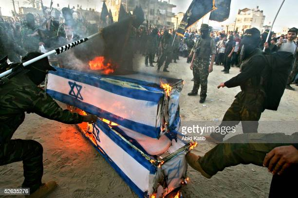 Coffins covered by Israeli flags are burned by The Islamic Al-Jihad Movement activists during a pro-election rally on April 15, 2005 in the Rafah...