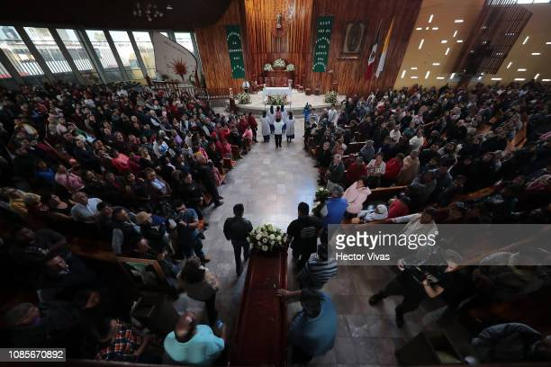 Coffins enter the Church of San Francisco de Asis during the funeral services of the victims of an explosion in a pipeline belonging to Mexican...