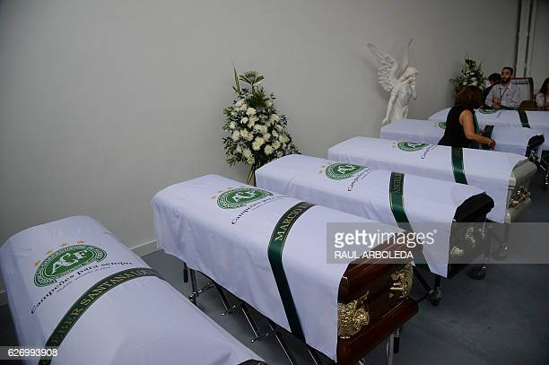 Coffins of members of the Brazilian football team Chapecoense Real the were killed in a plane crash in the Colombian mountains are seen at the San...