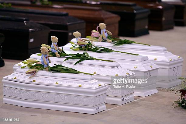 Coffins of some of the African migrants, including four children, killed in a shipwreck off the Italian coast sit in a hangar at the Lampedusa...