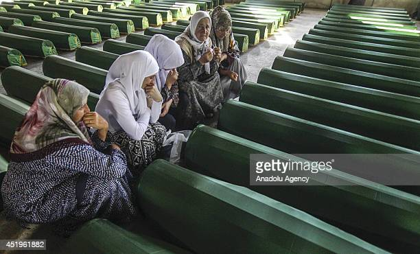 Coffins of the 175 victims of Srebrenica massacre committed by Serbian troops on July 11 wait in the old battery factory used as a base by the UN...