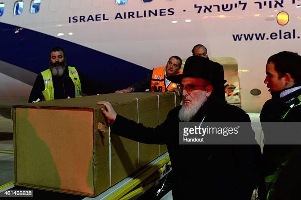 Coffins of the four Jewish terror victims who were killed during a hostage standoff at a kosher supermarket in Paris last week arrive at Ben Gurion...