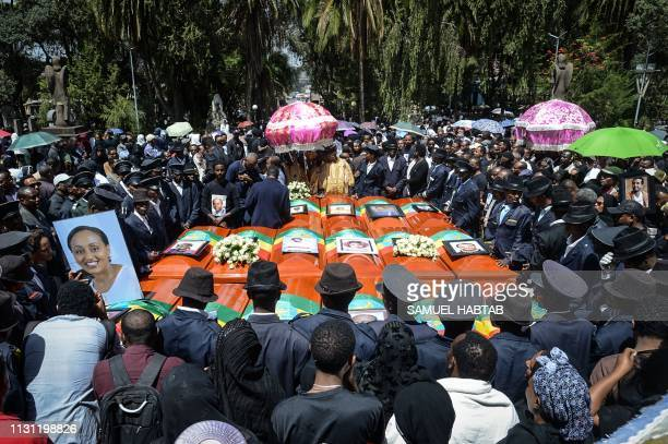 TOPSHOT Coffins of victims of the crashed accident of Ethiopian Airlines are gathered during the mass funeral at Holy Trinity Cathedral in Addis...
