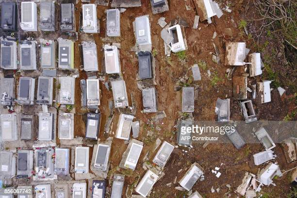 TOPSHOT Coffins that were washed downhill from the Lares Municipal Cemetery by a landslide are seen in the aftermath of Hurricane Maria in Lares...