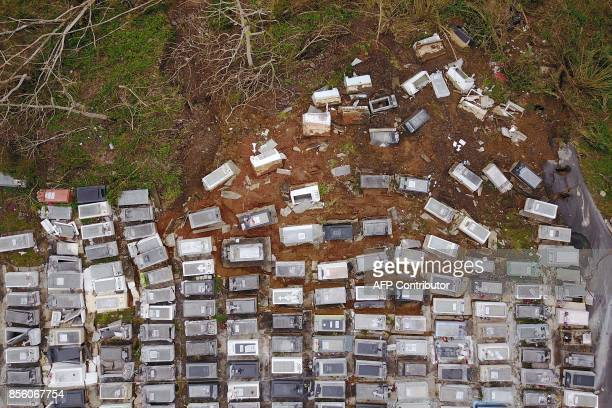 Coffins that were washed downhill from the Lares Municipal Cemetery by a landslide are seen in the aftermath of Hurricane Maria in Lares Puerto Rico...