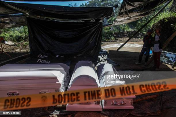 Coffins that will be used for the people who were killed by a landslide are seen inside a tent on September 18 2018 in in Itogon Benguet province...