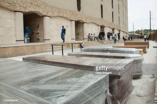Coffins with bodies await to be buried Jardines de Esperanza cemetery on April 10, 2020 in Pascuales, Guayaquil, Ecuador. Guayas Province and its...