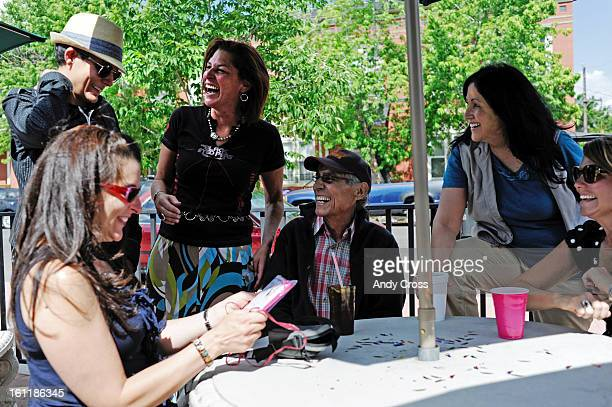 DENVER COFormer Colorado State Senator Paul Sandoval fourth from left along with his wife Paula fifth from left have a laugh with Paul's daughters...